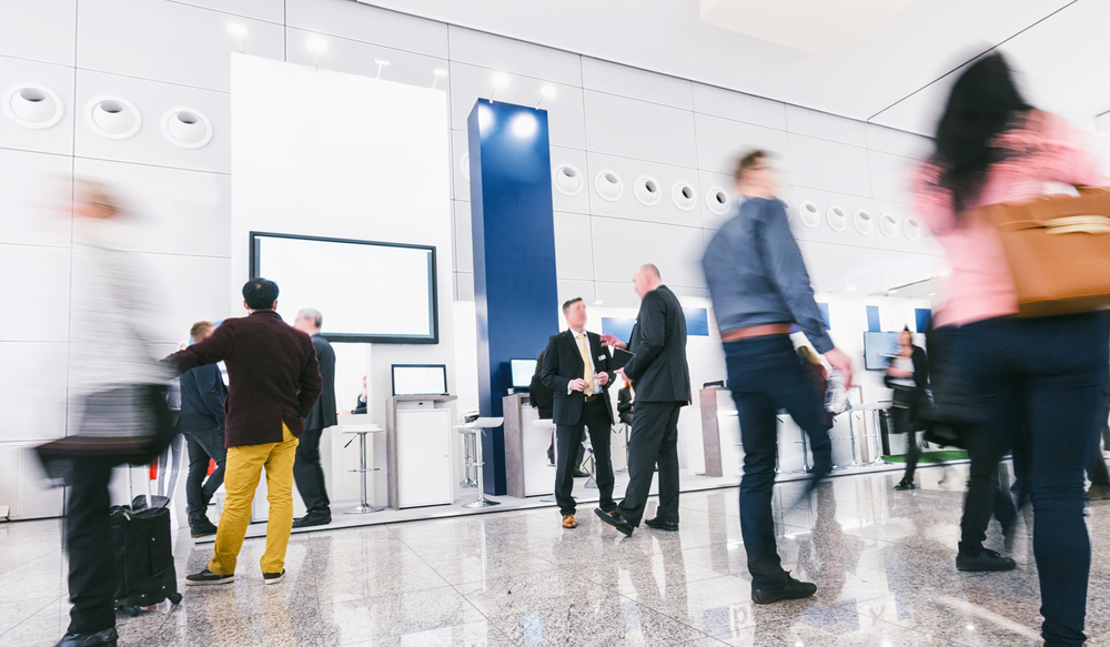 people walking during a networking trade show