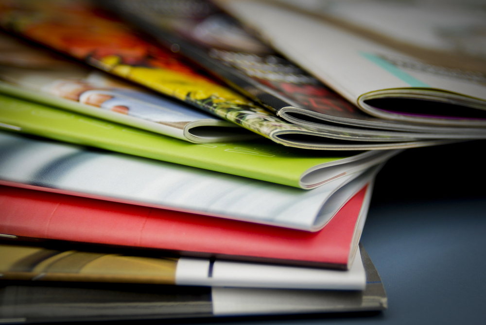 stack of colorful brochures